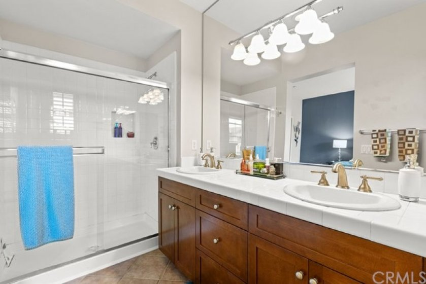 Another view of the Master Suite bath with a large walk in shower.