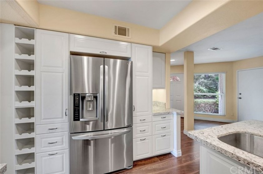 Custom wine storage and the counter depth stainless steel refrigerator is included