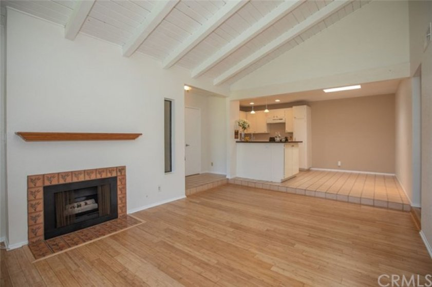 Gas fireplace with view of dining and kitchen area.