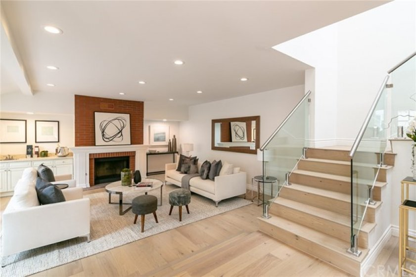 Living Room w Fireplace, Wet Bar and French Oak Floors