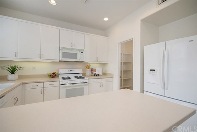 The kitchen features under counter lighting, and includes the refrigerator!