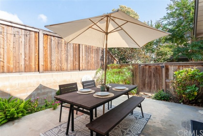 The patio is one of the larger ones in the community and is the perfect setting for evening barbeques. It features a gate that opens directly to the community paths as well as under-the-home storage.