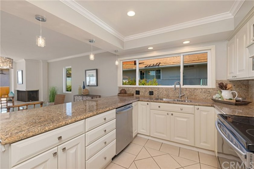 Kitchen is open to the main living areas of the home.
