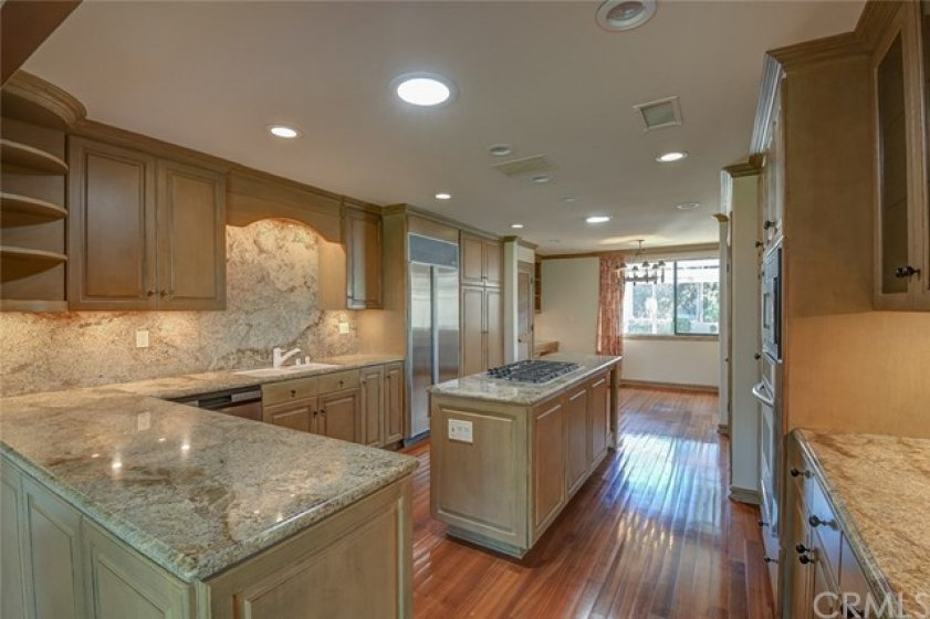 Views can also be enjoyed in the kitchen as it has been remodeled and opened onto the dining area
