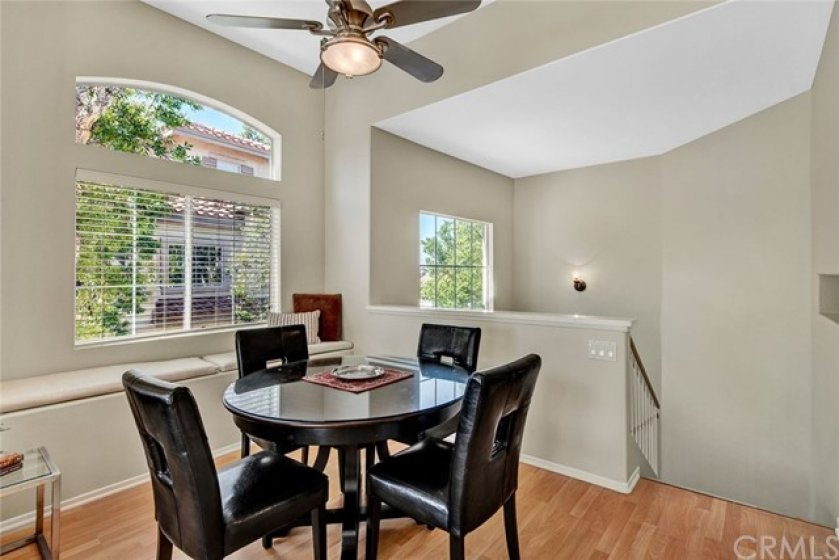Dining room wth ceiling fan and window seat, perfect for relaxing!