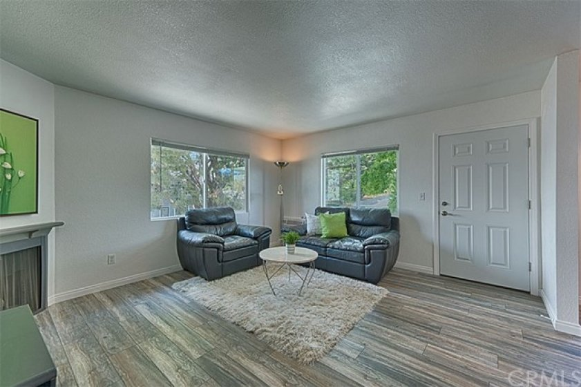 Another view of the beautiful wood laminate flooring and dual pane windows.