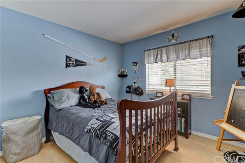 Bedroom # 3. All bedrooms upstairs have laminate flooring - easy maintenance and easy to keep clean.