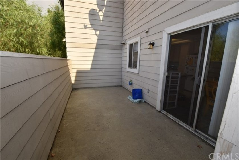 Private patio area at rear of unit.