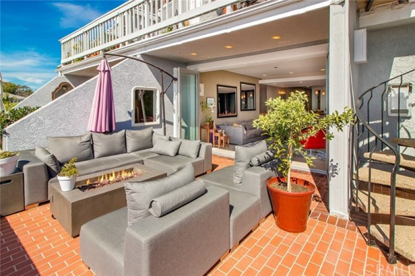 A stunning single-level home showcasing two bedrooms and two bathrooms along with breathtaking panoramic vistas of the crashing waves.
