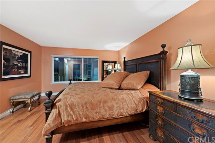 dramatic en-suite master features 2 closets, ocean view, bathroom with double sinks