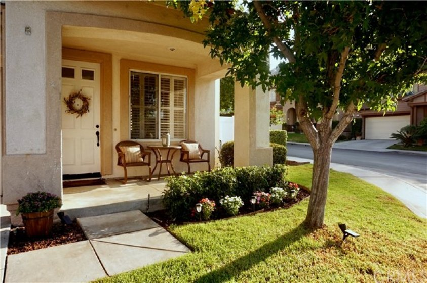 Friendly front porch is a restful spot to watch kiddos play on the front grass. Large corner lot.