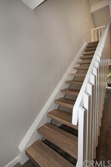 Stairs were individually wrapped with the laminate flooring.