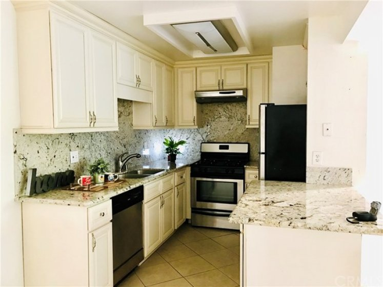 Remodeled Kitchen with Granite Counters, New Cabinets and Stainless Appliances.
