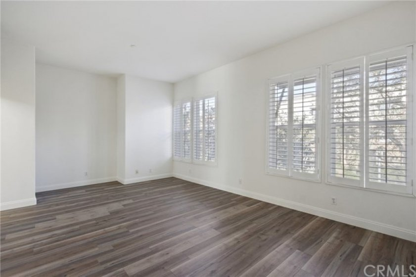 Master Suite with media niche, plantation shutters, new paint & new laminate floors