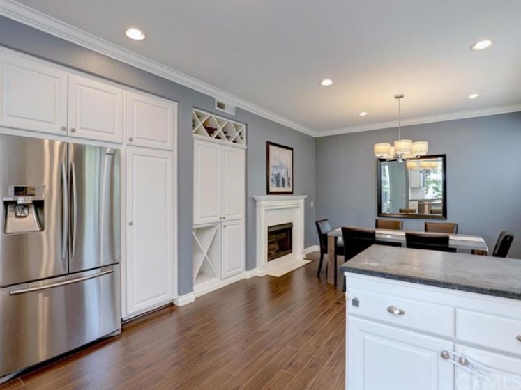 The multifunctional floorplan currently has the space next to the kitchen as a dining room, but with its fireplace and tons of light and wall space, it could be a family room.