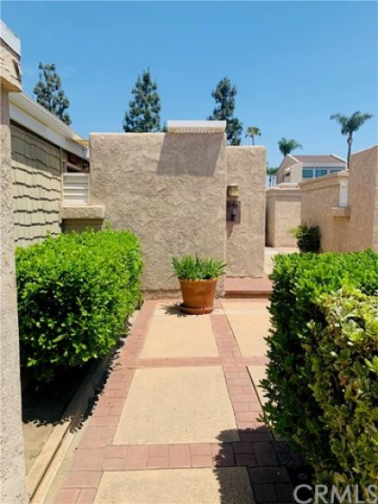 Walled entry to private patio in front of unit.