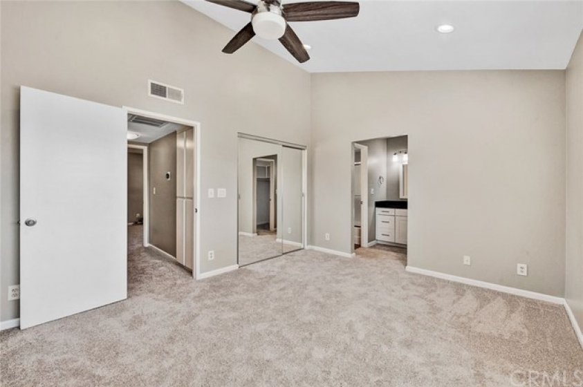 2 of 2 Dual Master Bedrooms....high ceilings with Recessed lights and Ceiling Fan