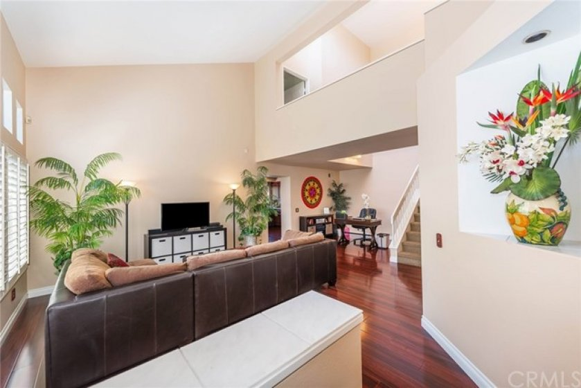 Warm and inviting entry featuring neutral decor and soaring ceilings.