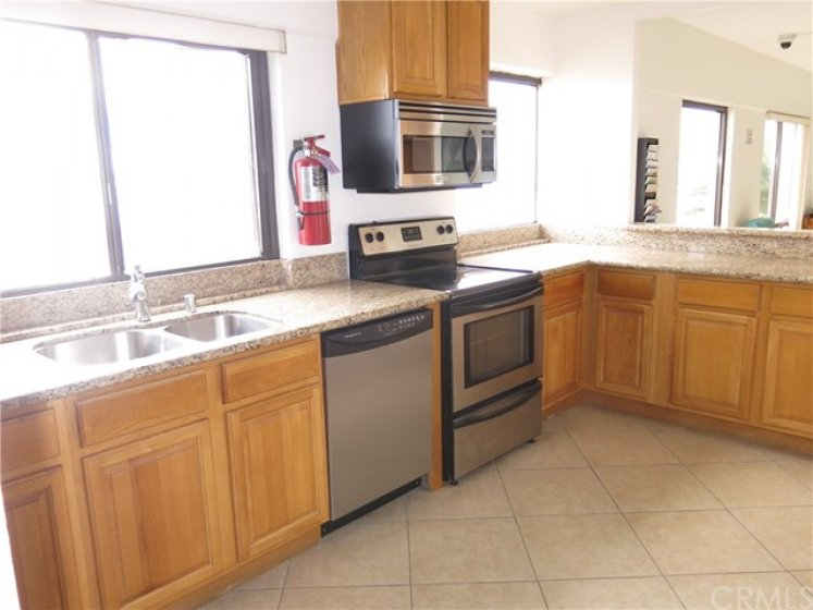 UPDATED KITCHEN IN THE COMMUNITY RECREATION ROOM