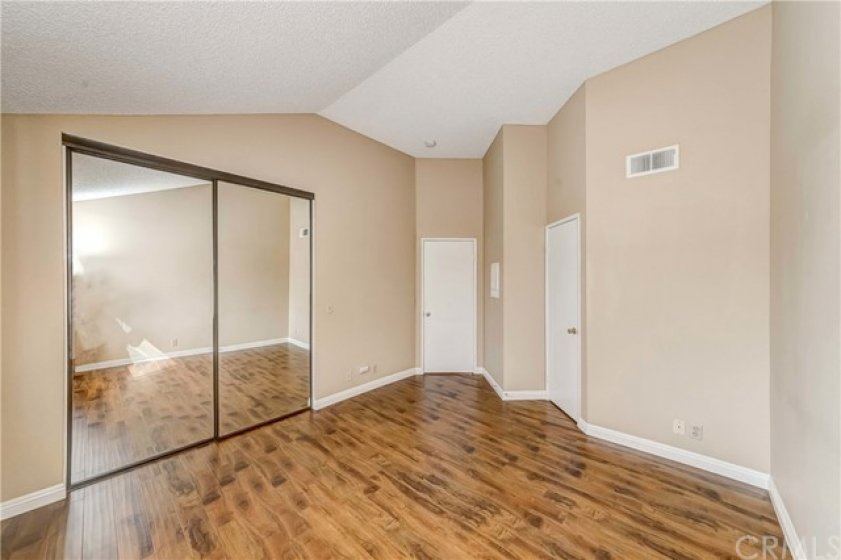 Master bedroom with high ceiling,  master bathroom, and walk in closet.