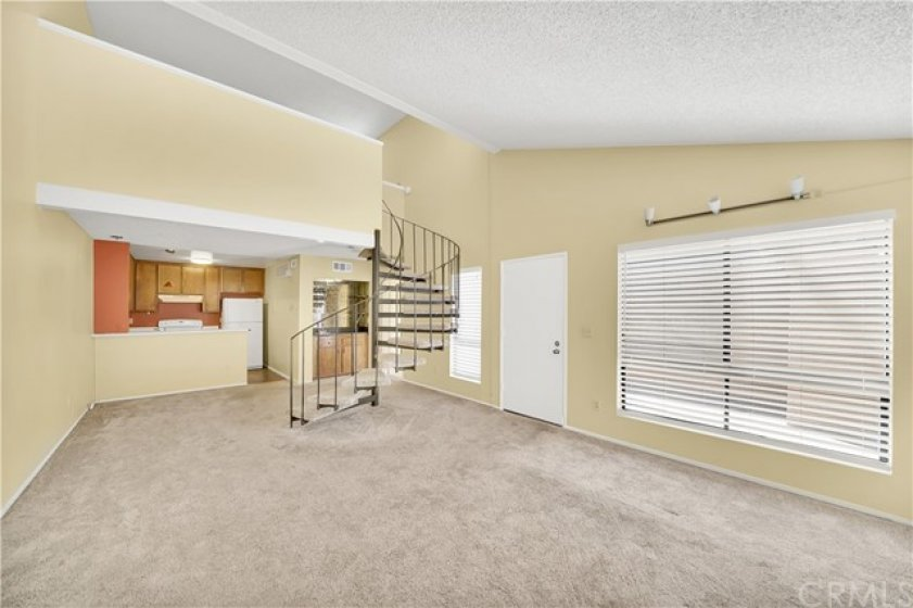 Another Great Shot of the Open Floorplan Livingroom with A Lot of Natural Light