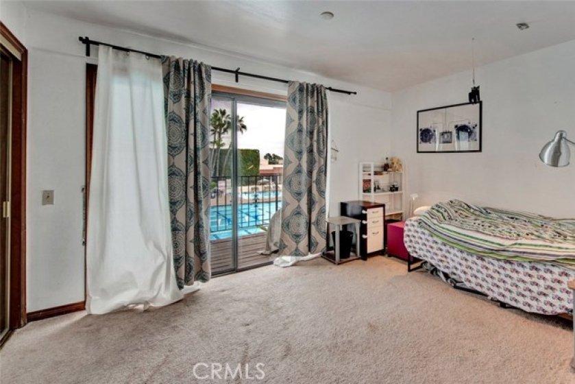 Bedroom w/ Balcony Overlooking Pool