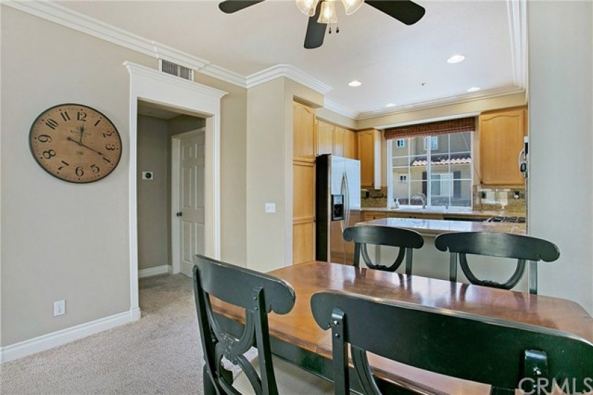Living/dining room details include crown molding and door frame detail.
