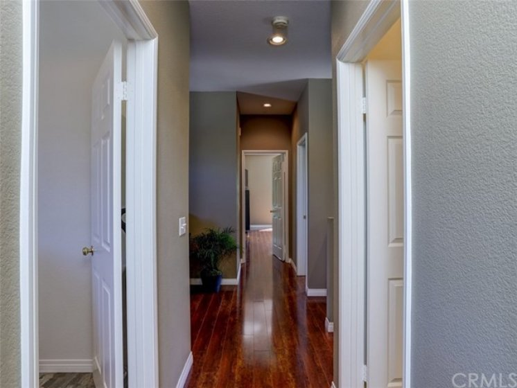 Wood laminate plank floors throughout the upstairs