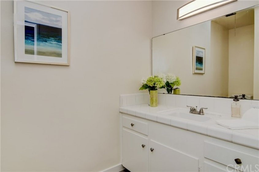 Crisp white details in the Master Bath. Newly glazed Shower and Door are opposite, just out of camera range.