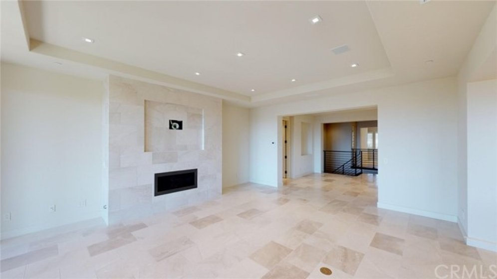 Great room with in floor electrical for furniture placement and detailed ceiling construction.