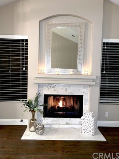 Upgraded Calcutta Gold Marble facing and fireplace hearth.