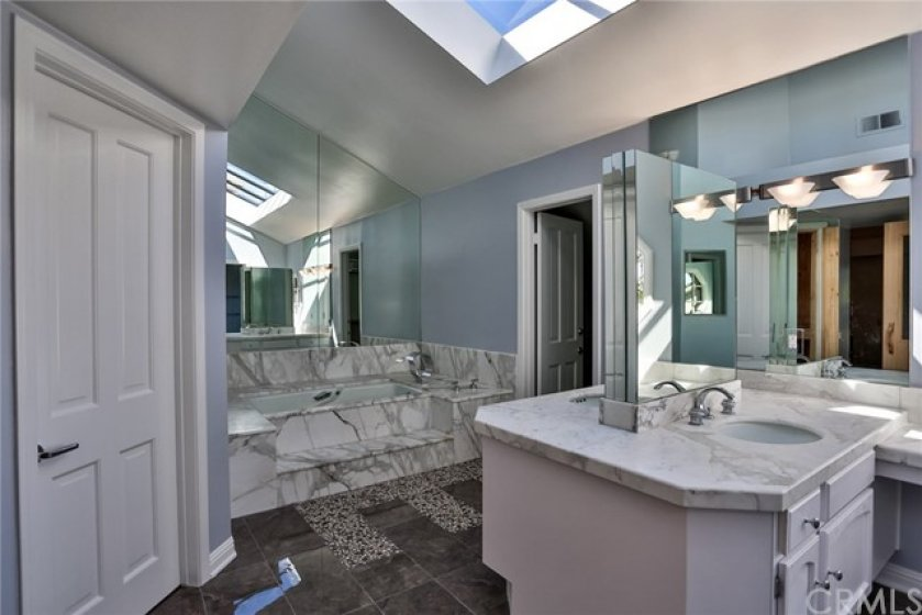 Master bathroom with jetted tub, walk in shower and Sauna