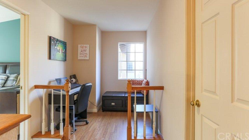 Loft/Den at top of stairs between 2 master bedrooms.