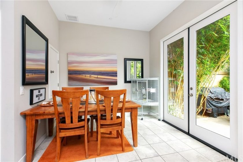 Large Floor to Ceiling Patio Doors lead to Private Backyard
