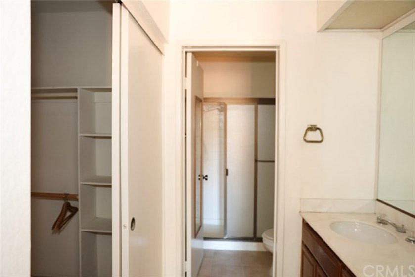 another view of master bath, dressing area and walk in closet