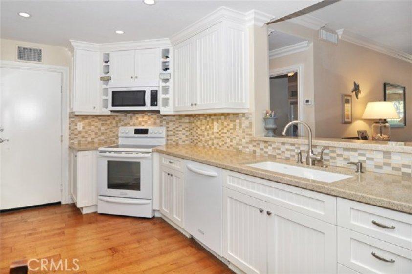Granite counters, glass back splash and KitchenAid appliances.