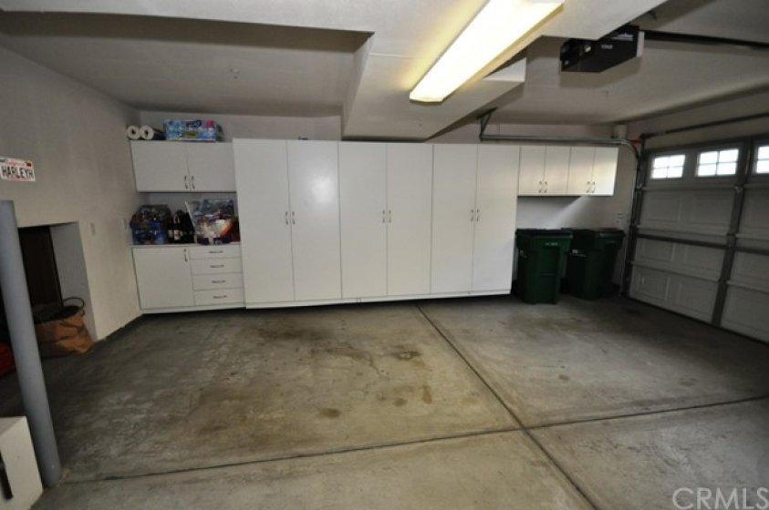 Garage has built-ins and additional storage space/area that can store bikes, holiday decorations, etc.