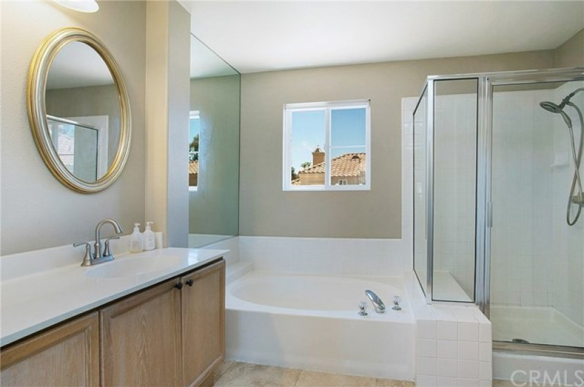 Master bath features separate shower and bath.