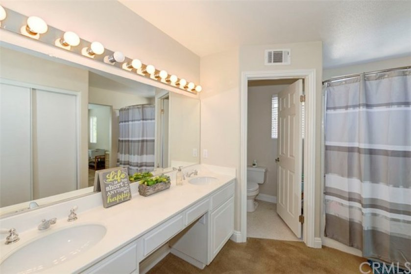 Master en suite featuring a large shower tub combo and a water closet.