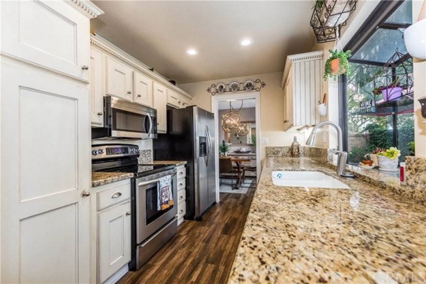 Upgraded kitchen with ample cabinetry and a garden window