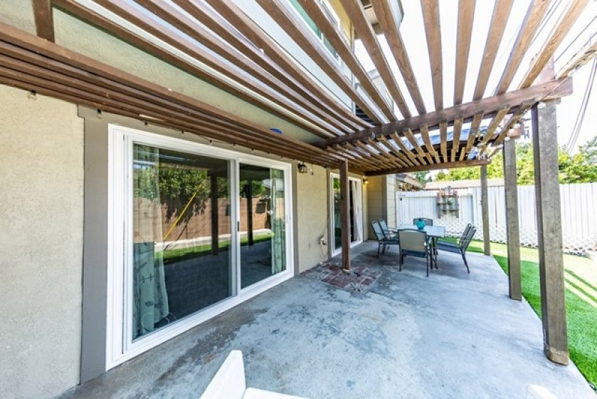 Sliding patio doors from family room and living room both lead to this private yard.