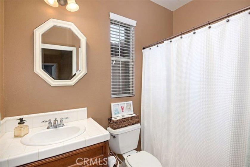 Second floor hall bath has shower over tub.