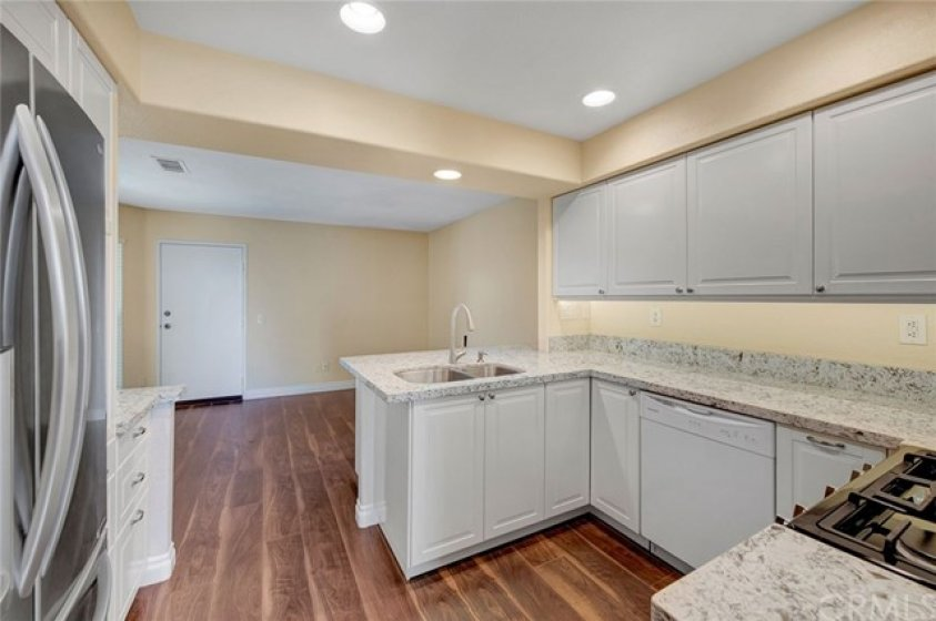 Remodeled kitchen with custom soft close cabinets/drawers, wine rack, and quartz countertops