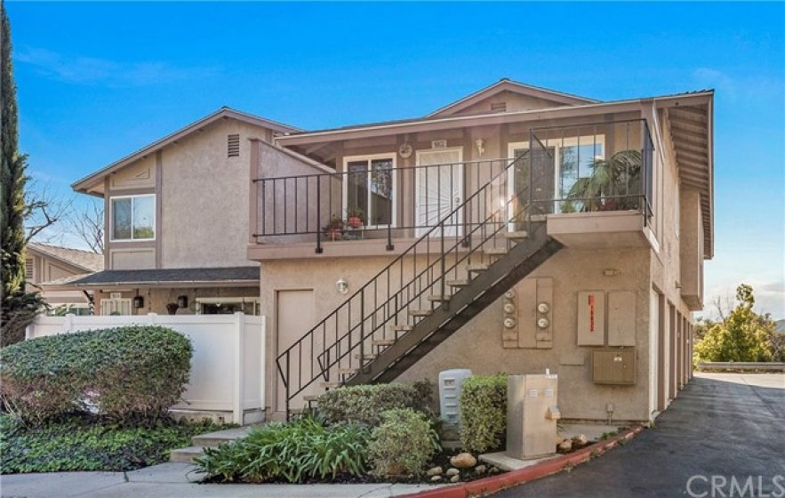 Home sits directly above the two car garage.  Garage has access from the alley way, as well as the door at the bottom of the stairs.