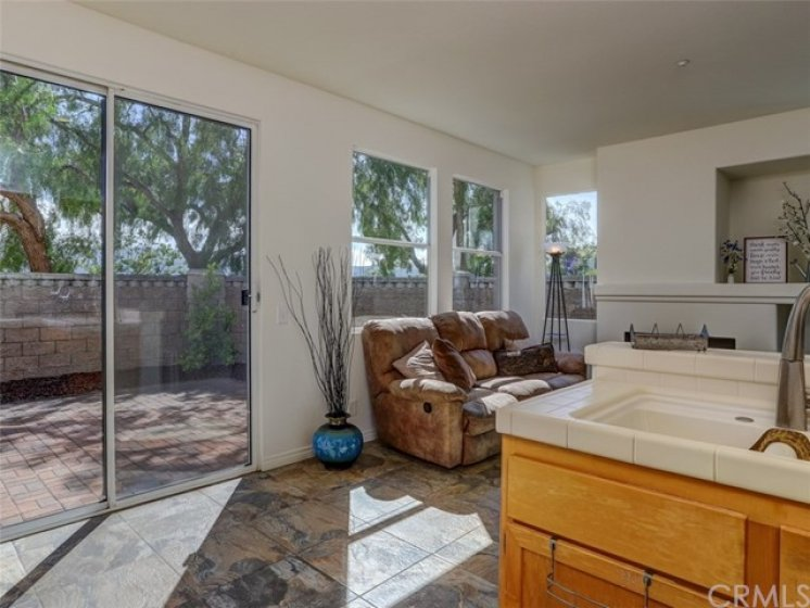 Sliding dual pane glass doors to backyard from family room