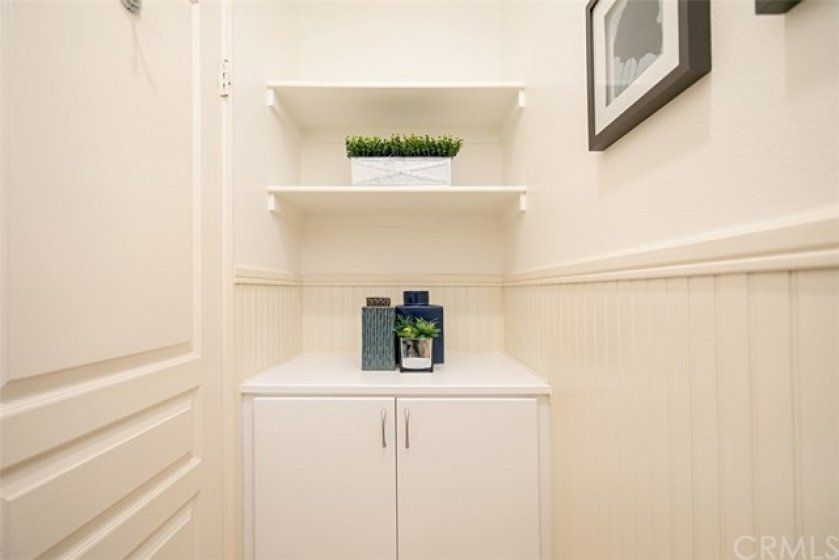 Private commode area has extra storage space and though not shown, has a magazine rack.