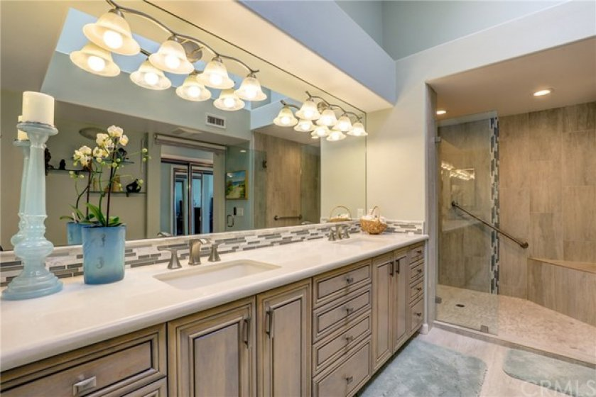 Stunning remodeled master bathroom with dual vanity and stall shower