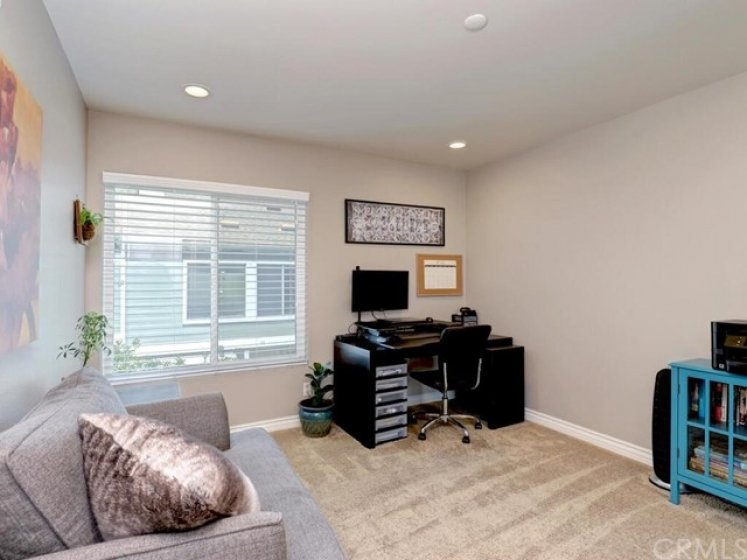 The secondary bedrooms are both light and bright and include recessed lighting.