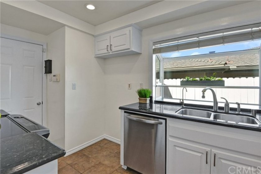 Kitchen w/ garden window brings in a lot of natural light and perfect for indoor herb garden.