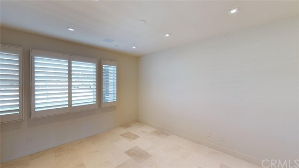 Additional loft/den area between secondary bedrooms with shutters.